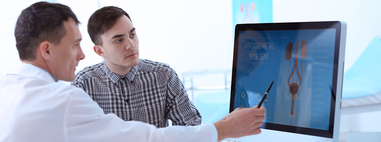 doctor showing educational information on computer to patient